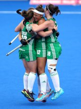 LONDON, ENGLAND - JULY 26: Elena Tice of Ireland celebrates victory with Roisin Upton of Ireland and Shirley McCay of Ireland during the Group B game between India and Ireland of the FIH Womens Hockey World Cup at Lee Valley Hockey and Tennis Centre on July 26, 2018 in London, England. (Photo by James Chance/Getty Images)