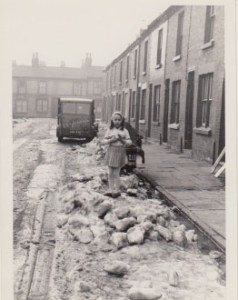 photo of little girl in a Toxteth street illustrating a page about writer, Grace Jolliffe