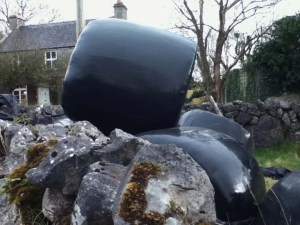 silage bales on stone wall illustrating a free children's story about the horses of Ballyyahoo - Ireland's magical town
