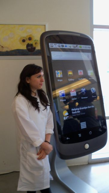 Photograph from the launch of the Google Nexus One phone with what appears to be a tinkerbell by the phone (actually the phone is a giant live model)