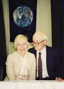 Shown here on the right is John McConnell together with his wife, Anna McConnell. Seen in the background, is the earth flag created by Mr. McConnell. Photo by Ann Charle