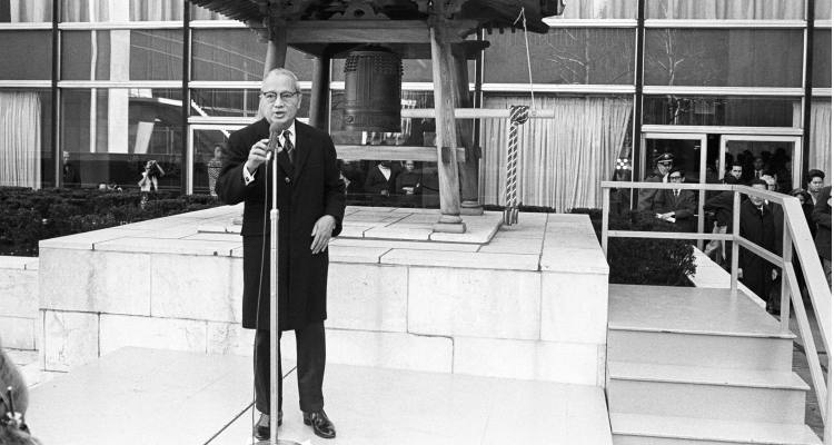 Shown here is UN Secretary-General U Thant making a statement before ringing the Peace Belln at United Nations on March 21, 1971. The ringing of the bell constituted the highlight of a ceremony proclaiming March 21 as Earth Day. Among those invited to attend were the Permanent Representative of Japan and the United States, the Observer of the Holy See, Monsignor Alberto Giovannetti, a group of children representing several nationalities from the United Nations International School, United Nations Correspondents, and Secretariat officials. UN Photo/Teddy Chen