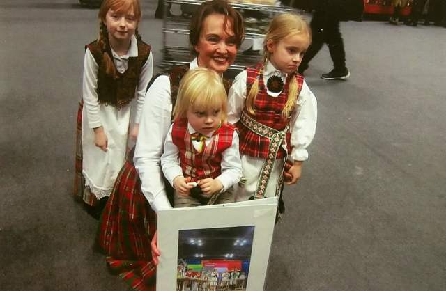 """Pictured at The 2016 New York Times Travel Show is director Violeta Kundrotienė, with Nora Farwell next to her on the left, and two other young performers from the Lithuanian children's group """"Spindulėlis"""" (Little Sun Rays) following a cultural performance at the Jacob K. Javits Convention Center during The 2016 New York Times Travel Show. Photo: Ann Charles"""