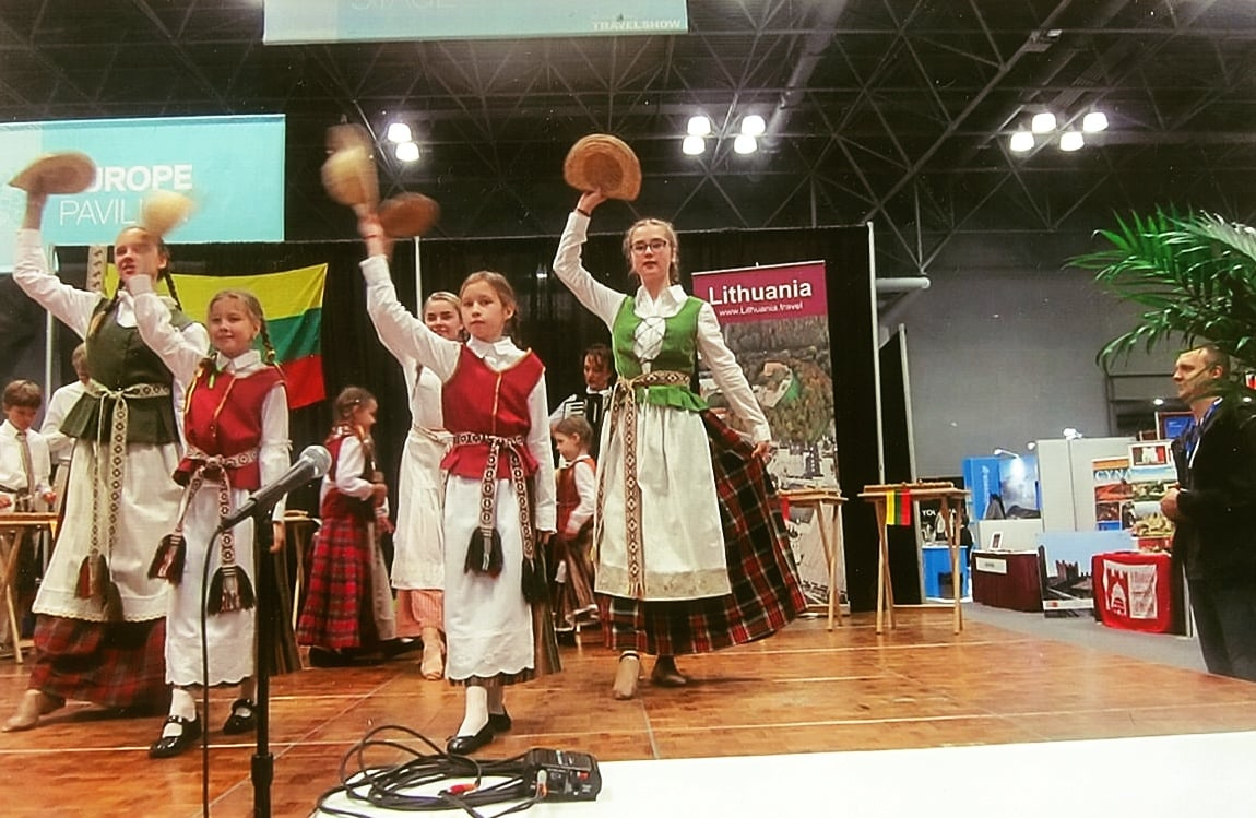 As you can see from this photo taken at The 2016 New York Times Travel Show, performing on stage to traditional Lithuanian music, playing handmade Lithuanian instruments, and sharing their Lithuanian culture with a global audience, instills pride in being Lithuanian. Photo: Ann Charles