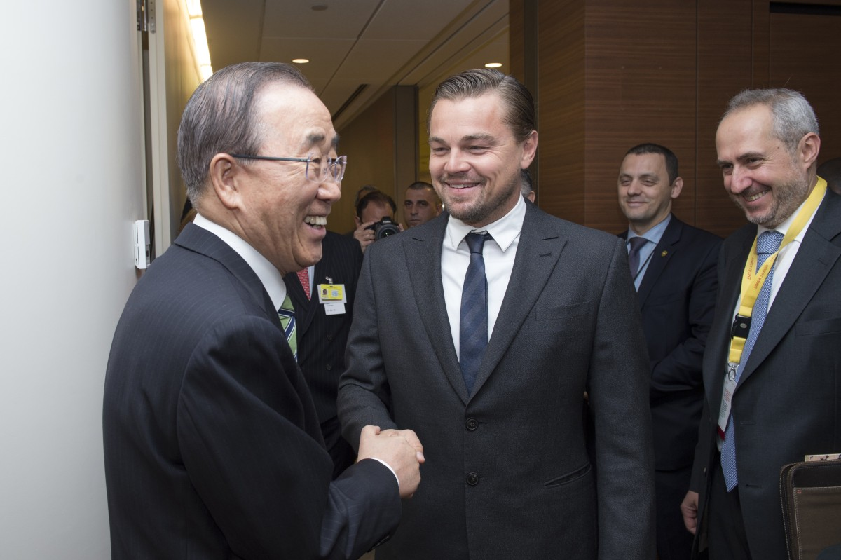 UN Secretary-General Ban Ki-moon is shown greeting UN Messenger of Peace Leonardo DiCaprio before the signing ceremony, as Stephane Dujarric, Spokesperson for the Secretary-General, looks on. UN Photo/ Eskinder Debebe.