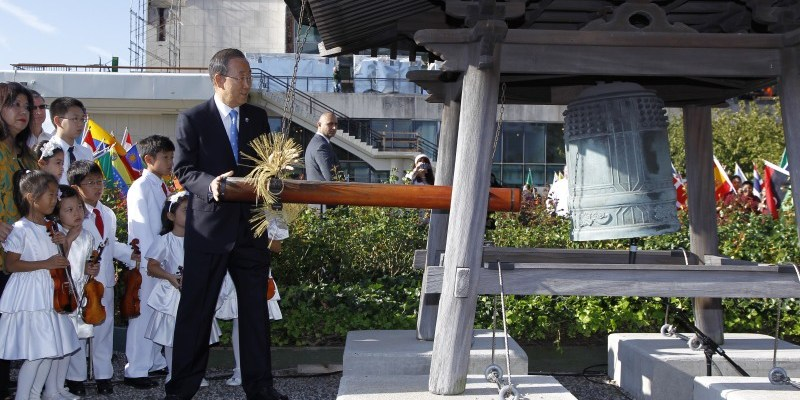 Shown here is UN Secretary-General Ban Ki-moon ringing the UN Peace Bell to mark the annual International Day of Peace which is observed around the world on September 21. The UN General Assembly has declared this as a day devoted to strengthening the ideals of peace, both among all ations and peoples. Pictured with Ban Ki-moon are the peace-loving Tarumi Violinists, under the direction of Yukako Tarumi, who will perform at this year's International Day of Peace celebration at UN Headquarters. UN Photo/Paulo Figueiras