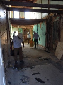 We then moved down to the first floor. Here in the second unit, #2330, we had to remove carpet, flaky carpet padding, linoleum, and plywood. Once all that was out of the way, we got down to the original floor.