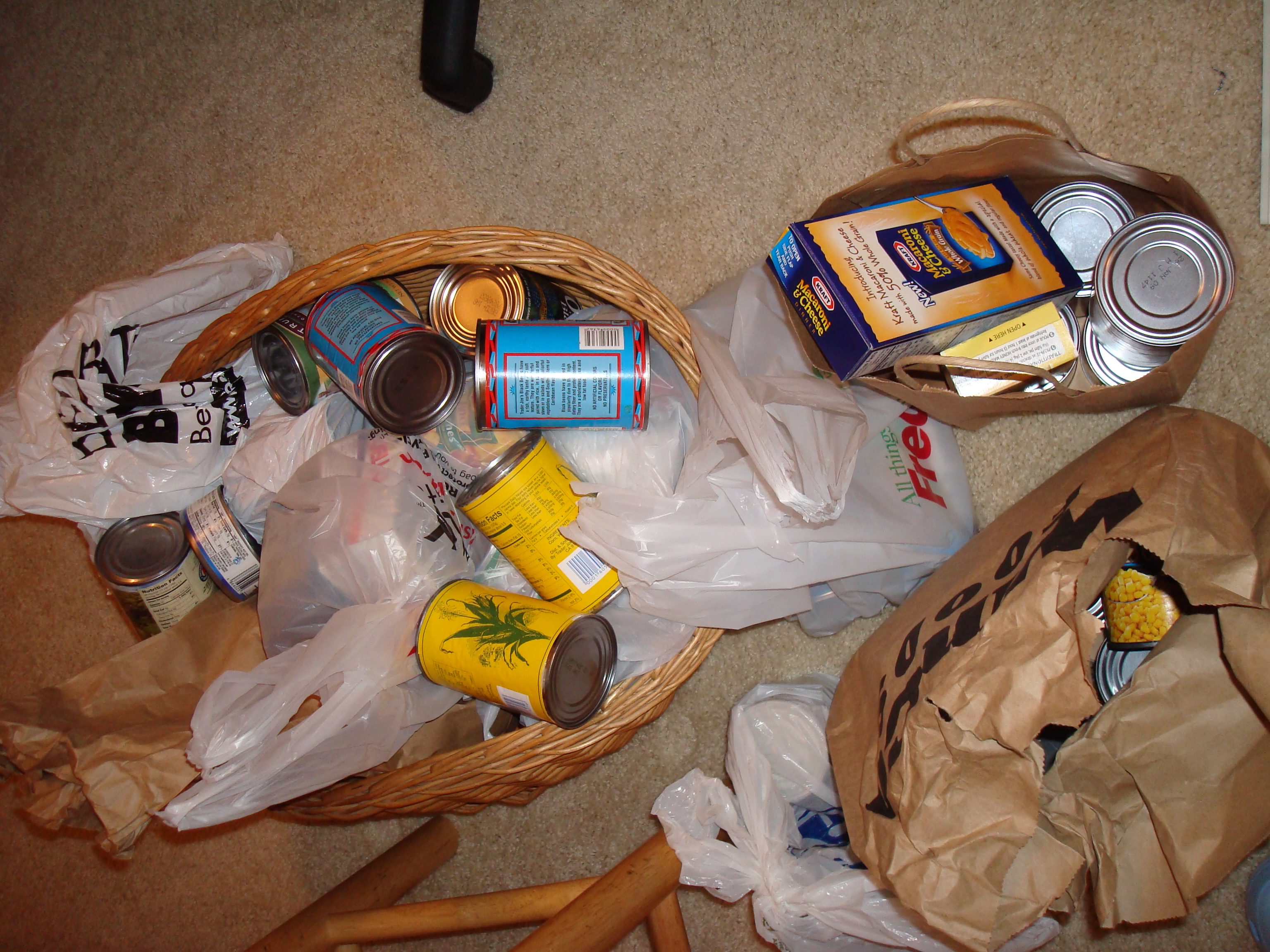 Over-flowing pile of canned goods collected for food bank.