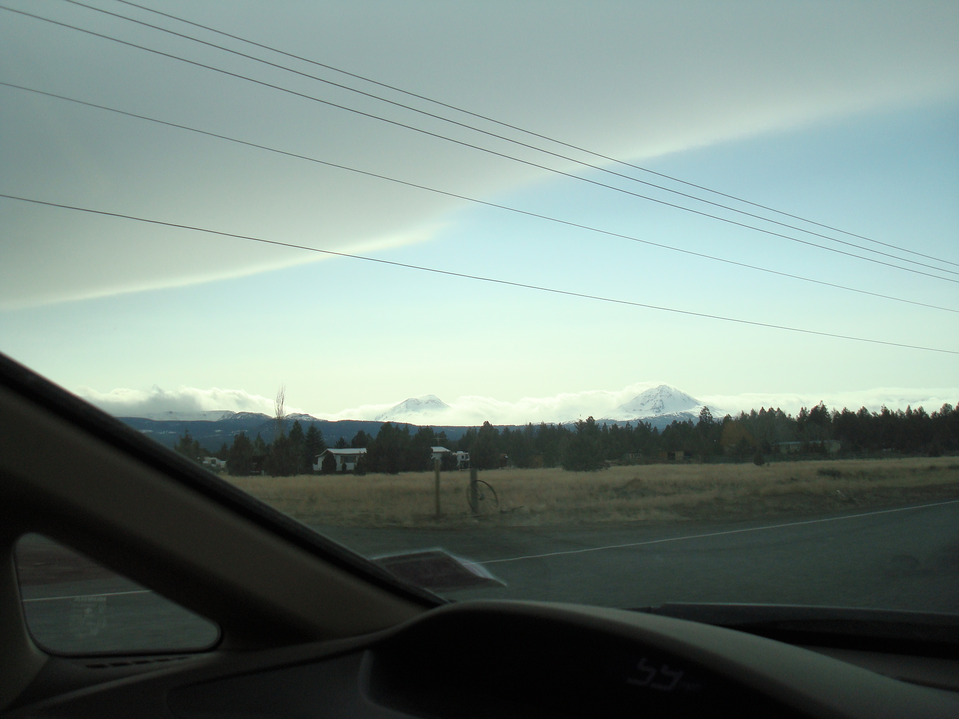 On the road outside Bend (Cascade peaks: I can't tell if the Three Sisters or Mt. Washington from the photo)