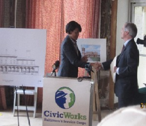 Mayor Rawlings-Blake signs Clifton renovation rendering with Civic Works Director Dana Stein