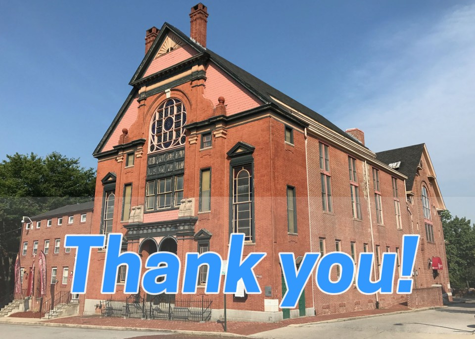 """A red brick church overlaid with blue text reading """"Thank you!"""""""