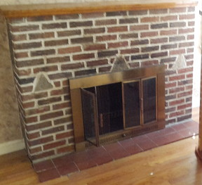 Typical fireplace with a brick hearth.