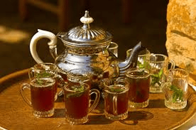 Traditional Tunisian Green Tea with mint being served at a Tunisian wedding.
