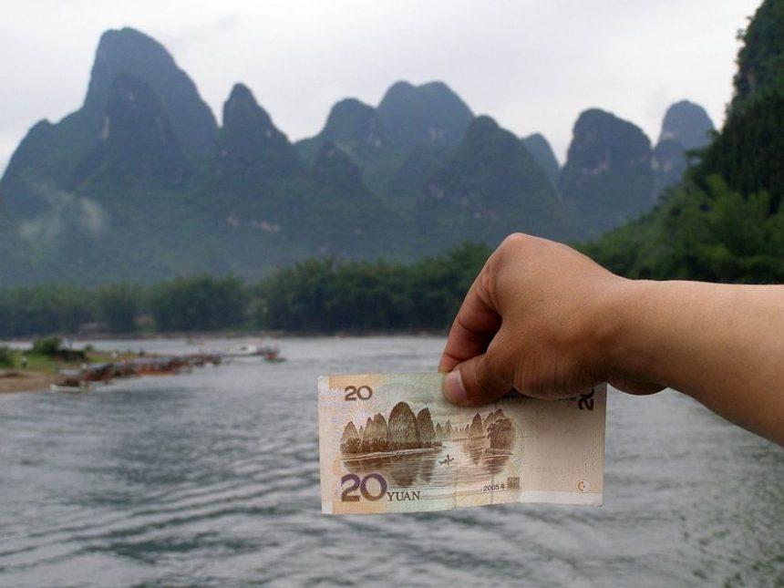 Li-Fluss und 20 Yuan Schein