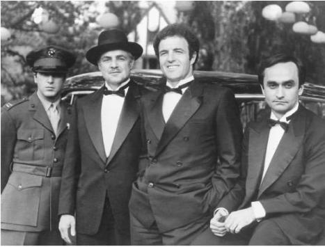 Whereas the brothers opted for double-breasted dinner suits, as were fashionable during the late 1930s-early 1940s, Don Corleone keeps his look classic with a 1-button peak lapel tux.Did you know? The costume department only had three tuxedos on hand so they gave Al Pacino a Marine uniform to wear and wrote it into the movie? (I made that up.)