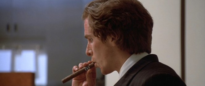 Check out the label! All of Bateman's cigars are La Plata. This is a cinematic choice, as Ellis's book gave no cigar brand by name.