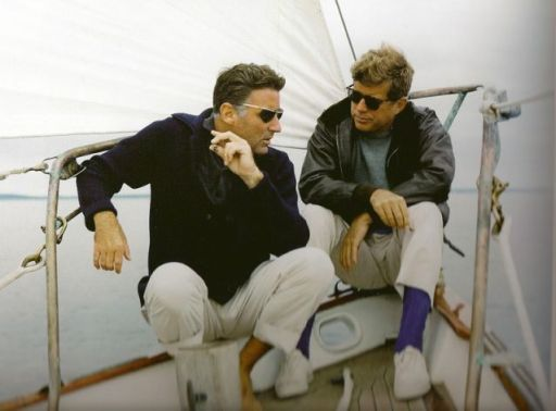 Kennedy wears a bomber jacket while entertaining none other than Rat Packer (and brother-in-law) Peter Lawford on his yacht.
