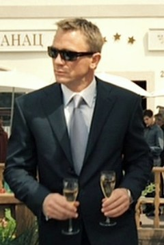 Daniel Craig double-fisting champagne as James Bond in Casino Royale.