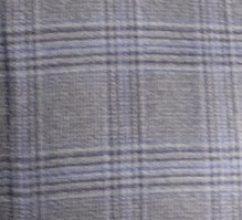 A close-up of the color detail on Nucky's Glen Plaid suit. This particular cut is taken from the right front side of the jacket; one of the darts is just visible on the far left.