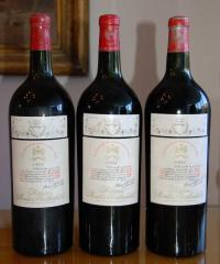 Three bottles of Mouton Rothschild claret dating back to 1945.