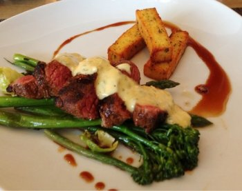 Steak with Bearnaise sauce and asparagus. The polenta fries are a nice touch, but unfortunately not used in any Bond novels.