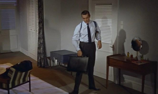 Bond surveys his hotel room.