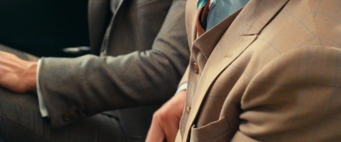 Gatsby's warm brown suit works with the cooler blue motif to set a comfortable summer tone.