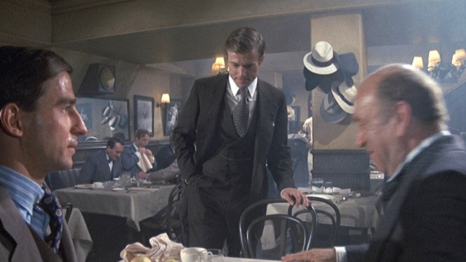 Note Gatsby's hat hanging on the hook behind him.