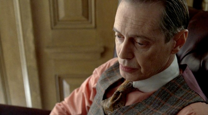 Nucky holding court in his office at the Ritz.