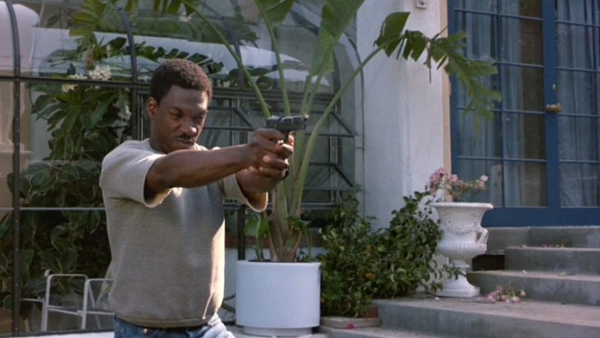 Eddie Murphy displays an impressive grip and handling techniques when firing his Hi-Power in the film.