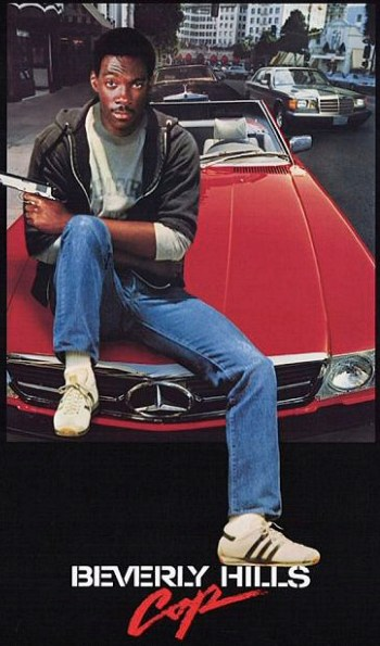 Eddie Murphy posing as Axel Foley for the Beverly Hills Cop (1984) poster. Like most movie posters, it replaces the gun he actually used in the film (Browning Hi-Power) with an incorrect airbrushed replacement (M1911A1).