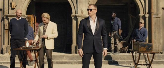Bond stands around as Silva prepares some shots of Scotch.