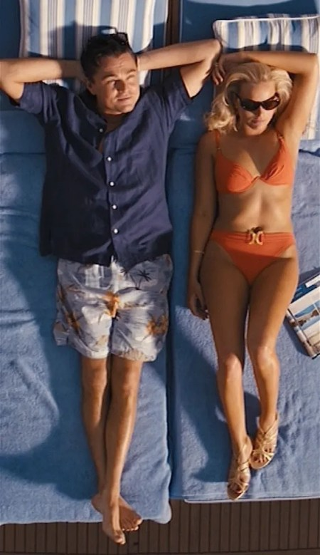 Leonardo DiCaprio and Margot Robbie as Jordan and Naomi Belfort in The Wolf of Wall Street (2013).