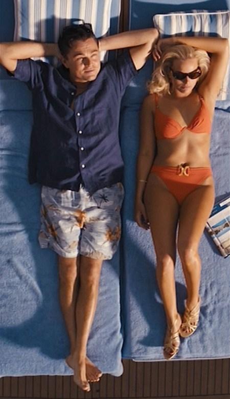 Leonardo DiCaprio and Margot Robbie as Jordan and Naomi Belfort in The Wolf of Wall Street (2013).