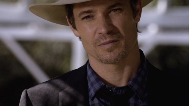 """Raylan stares down a potential adversary in """"Fixer"""" (Episode 2.03)."""