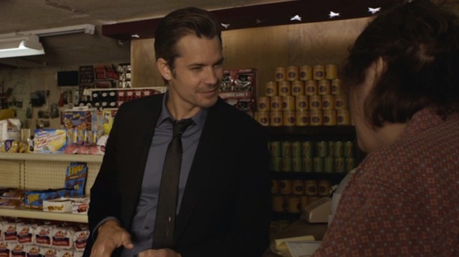 """Raylan can't resist a swallow of the titular beverage in """"The Moonshine War"""" (Episode 2.01)."""