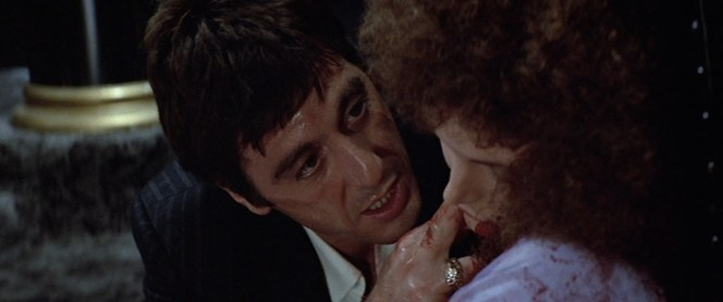 "Tony ""comforting"" Gina gives us another good look at his big diamond ring and the chalkstripes of his suiting."