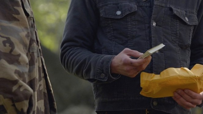 The metal buttons of Boyd's trucker jacket are best seen when he's accepting a gift from his loving father.
