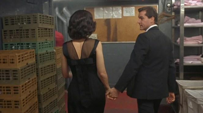 Henry leads Karen through the Copa kitchen.