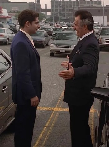 Christopher receives some needed sartorial advice from the always dapper Paulie Walnuts.