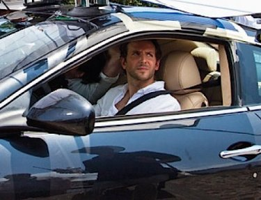 Bradley Cooper as Eddie Morra, behind the wheel of a Maserati GranTurismo while filming Limitless (2011).