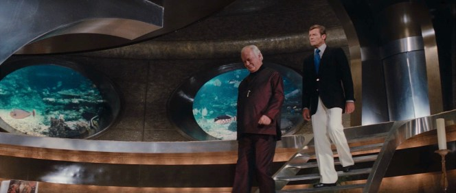 Bond's flared trouser bottoms dramatically envelope his loafers as he glides down into a villain's maritime lair.