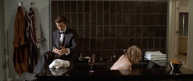 "Bateman briefly ignores his bathing ""guest"" to take a phone call."