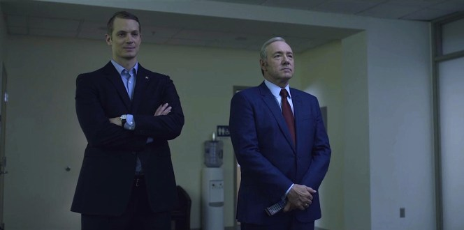 "Despite his opponent's taller height, <a href=""https://www.reddit.com/r/FanTheories/comments/2y7my1/request_house_of_cards_hbo_frank_underwood/"">American flag pin</a>, and smugly self-satisfied expression, Underwood looks more presidential in his made-to-measure suit and red power tie."