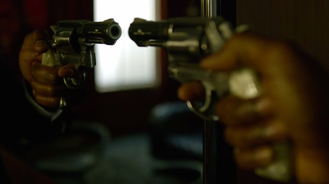 "Cottonmouth ignores the rules of both gun safety and good luck when he aims his Smith & Wesson Model 64 at the mirror in ""Manifest""."