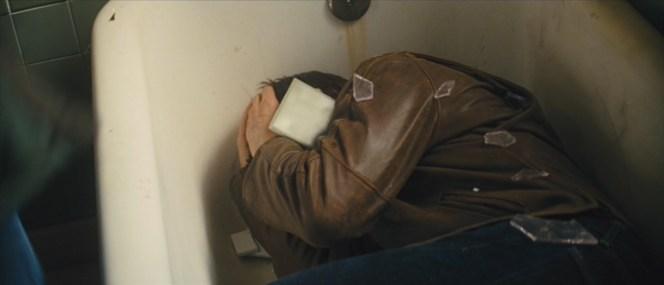 Reacher takes cover in a bathtub.