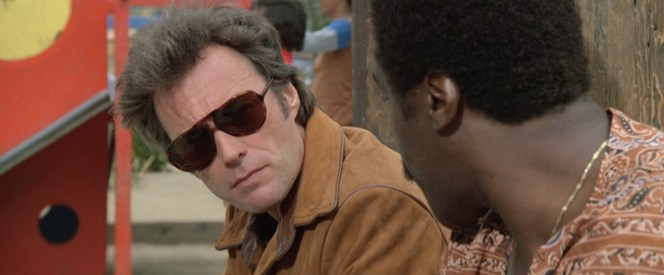 Harry swaps in a pair of trendy sport aviators after wearing his wraparound Ray-Ban Baloramas in <em>Dirty Harry</em> and <em>Magnum Force</em>.