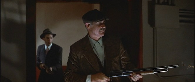 Malone delivers a 12-gauge message to the Capone organization.