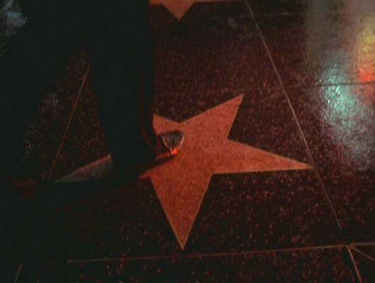 A gangster arrives in Hollywood; no image could better encapsulate the film's plot than the mafioso-evoking alligator loafer stepping on a Walk of Fame star.
