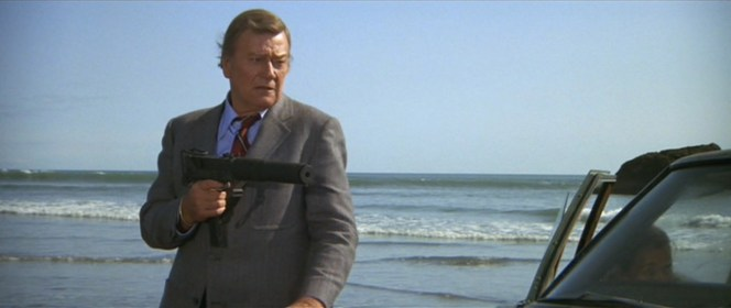 Ever the cowboy, John Wayne even fires his MAC-10 one-handed and from the hip.